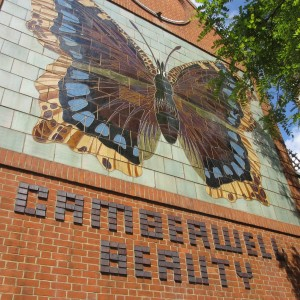 Mural with the words Cameberwell Beauty picked out in brick beneath