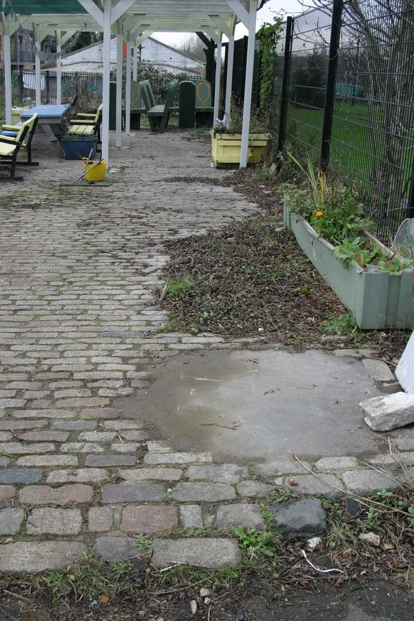 Cobbles before removal, garden pergola built on top