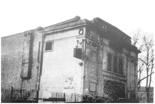 Black and white photo of front and side of building