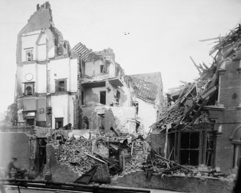 Several collapsed terraced houses, including 4 storey buildings