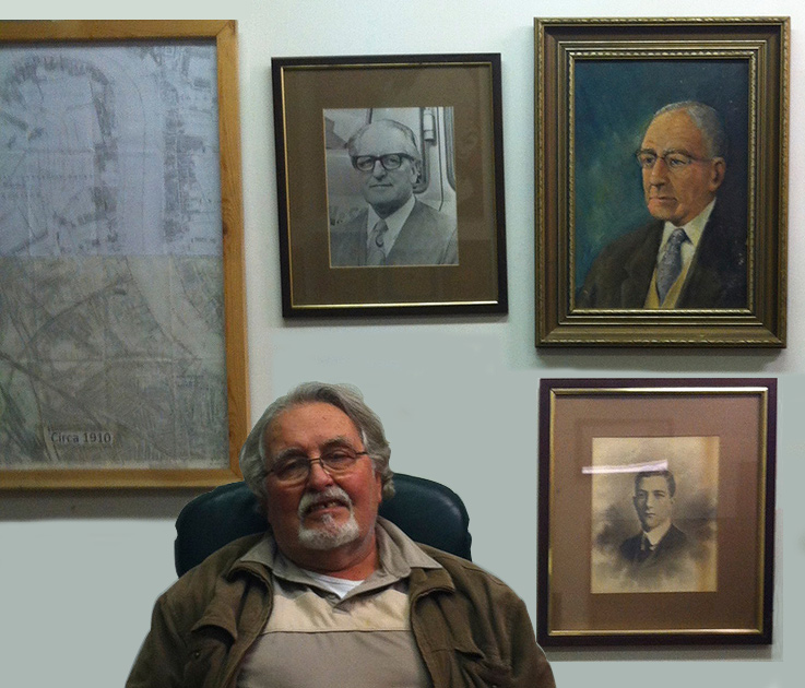 Photograph of Robert Whitten with paintings and photographs of the Whitten forebears