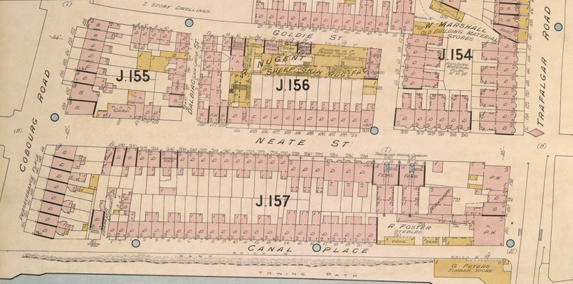 Coloured plan showing the location of terraced houses on Neate St, with the Nugent Factory behind on Goldie St. The block is numbered J.156.