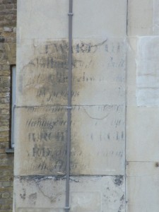 Very indistinct 19th Century sign painted on stone
