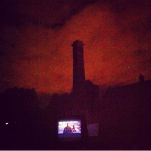 Photo of Old Library chimney with movie screen below