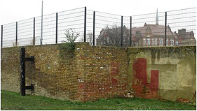 photo of wall next to the astroturf