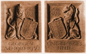 Lion and Unicorn emblems with dates 1910-1936