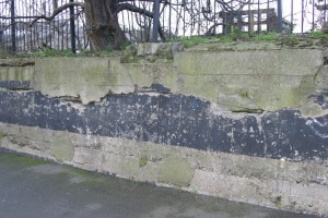 Two stone blocks just visible, embedded in concrete