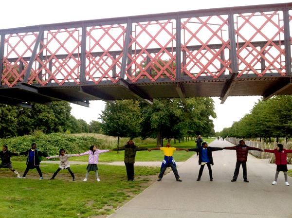 Photo of children holding hands and stretching under the bridge to nowhere to discover how wide the canal was.