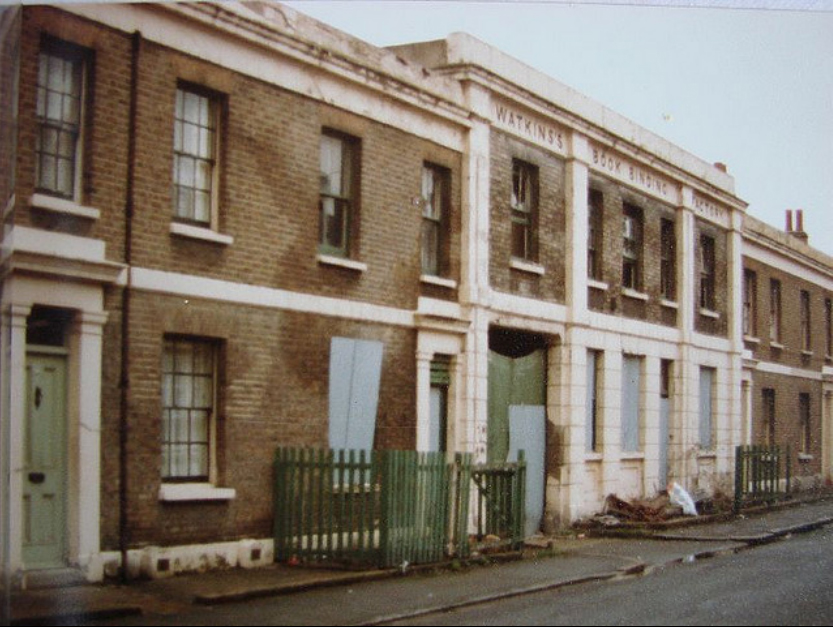 Boarded up factory in centre of Victorian terrace