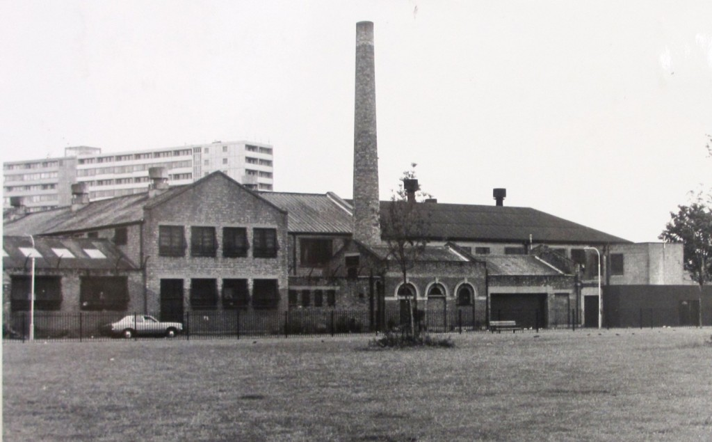 Tall chimney in forground, with Aylesbury Estate tower block behind