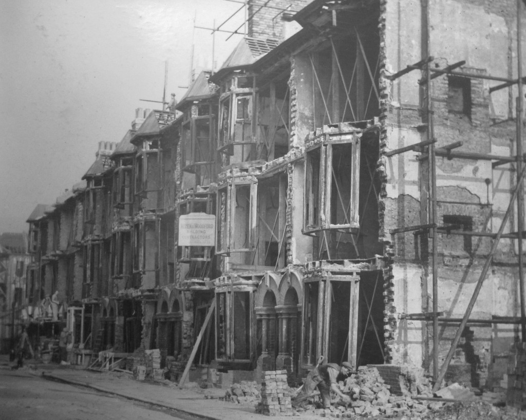 A row of quite grand 3-storey terrace houses, almost entirely missing their front walls